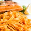 Tasty pasta with salmon - Stock fotografie