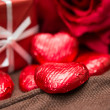 Chocolate, gift box and flowers — Stock Photo