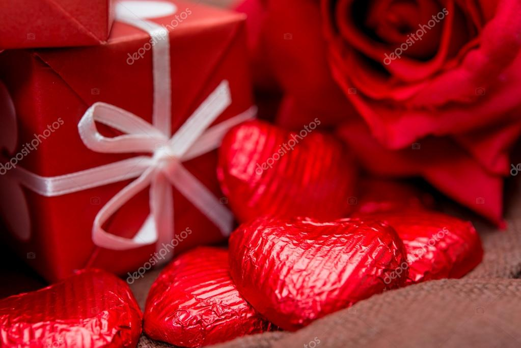 Gift box, chocolate and flowers for Valentine's day — Stock Photo #19834499