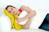 Woman sleeping on a couch — Stock Photo