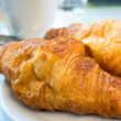 Coffee and croissants — Stock Photo #22956858