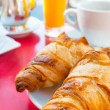 Coffee and croissants — Stock Photo #24273523