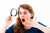 Dramatic woman with magnifying glass — Stock Photo