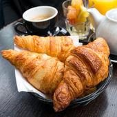 Coffee and croissants — Stockfoto