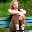 Stock Photo: Womsitting on bench in park