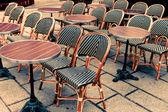 Empty coffee terrace in paris — Stock Photo