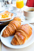 Breakfast with coffee and croissants — Stockfoto