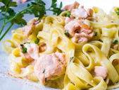 Tasty pasta with salmon — Stock Photo