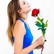 Woman with a flower and thinking about love — Stock Photo