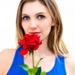 Woman with a flower in her hands — Stock Photo