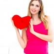 Woman holding a red heart — Stock Photo #26943631