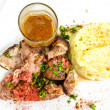 Stock Photo: Juice roasted lamb and potatoes
