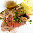Stockfoto: Juice roasted lamb and potatoes