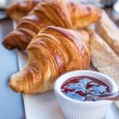 Breakfast with coffee and croissants — Stock Photo #28236203