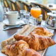 Breakfast with coffee and croissants — Stock Photo #28236257