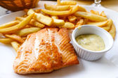 Grilled salmon and fries — Stock Photo