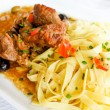 Plate of pasta and pork — Stok fotoğraf