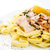 Tasty pasta with salmon — Stock Photo