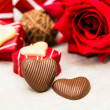 Sweet heart shaped chocolates candies — Stock Photo