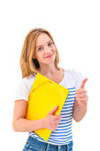Young smiling woman thumb up and holding notepad — Stock Photo
