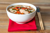 Bowls of Asian soup noodles and vegetables — Stock Photo