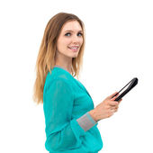 Young woman holding in hand a tablet touch pad — Stock Photo