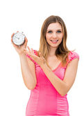 Woman holding a clock on a white background — Stok fotoğraf