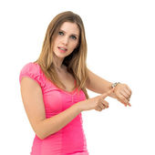 Woman checks time on her wrist watch — Stock Photo
