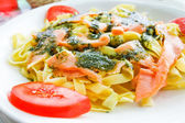 Pasta and smoked salmon with tomato — Stock Photo