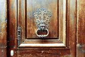 Wooden door with metal handle — Stock Photo