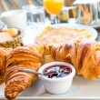 Breakfast with coffee and croissants — Stock Photo #34865317