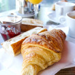 Breakfast with coffee and croissants — Stock Photo