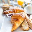 Breakfast with coffee and croissants — Stock Photo #34868731