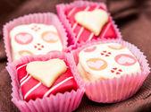 Sweet heart shaped chocolates candies — Stock Photo