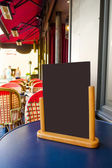 Restaurant's terrace with blackboard — Stock Photo