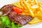 Steak beef meat with tomato and potatoes — Stock Photo