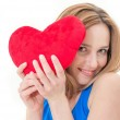Young woman holding a red heart — Fotografia Stock  #39344863