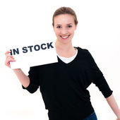 Young woman with board in stock — Stock Photo