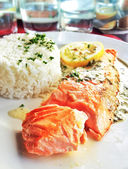 Salmon with lemon and rice — Stock Photo