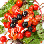 Delicious fresh tomatoe salad — Stock Photo