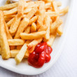 Golden French fries potatoes — Stock Photo #42574897
