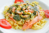 Pasta and smoked salmon with tomato — Stok fotoğraf