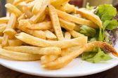 Golden French fries potatoes — Stok fotoğraf