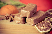 Chocolate on the wooden table — Stock Photo