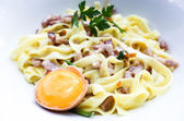 Pasta with roast ham on the table — Foto Stock