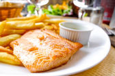 Salmon and Golden French fries — Stock Photo