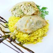 Moroccan Pastilla with saffron rice — Stock Photo