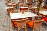 Coffee terrace with tables and chairs — Stock Photo