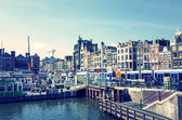 Beautiful view of Amsterdam canals with bridge and typical dutch — Stock Photo