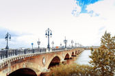 Old stony bridge in Bordeaux — Stock Photo